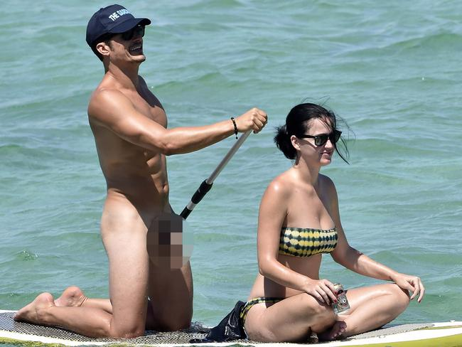 Bloom, pictured here with ex girlfriend Katy Perry, was blissfully unaware of watching photographers. Picture: australscope