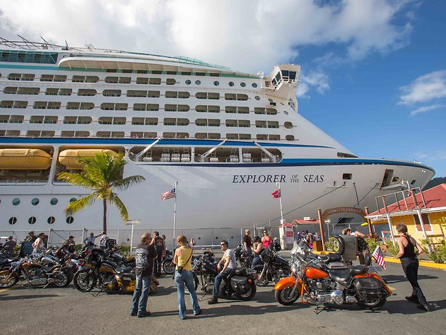 Passengers prepare to board the Explorer of the Seas, docked at Charlotte Amalie Harbor in St Thomas in the US Virgin Islands. Picture: AP