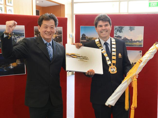 Wyong Mayor Doug Eaton (right) with Australia-Chinese Theme Park chief executive officer Bruce Zhong at last week's launch of new plans for the Warnervale attraction.