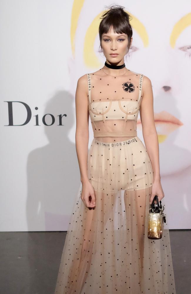 Dior face Bella Hadid showed off a bare demeanour with a Dior-branded bra and knickers. Picture: AFP