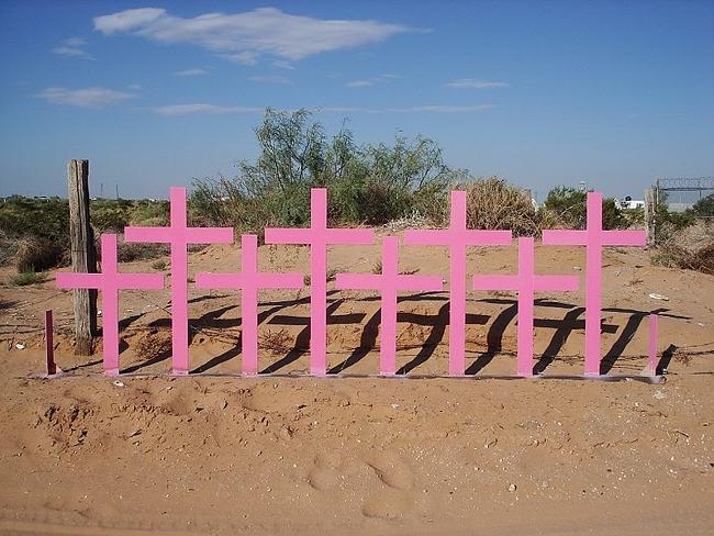 Mass grave of females are marked with pink crosses.