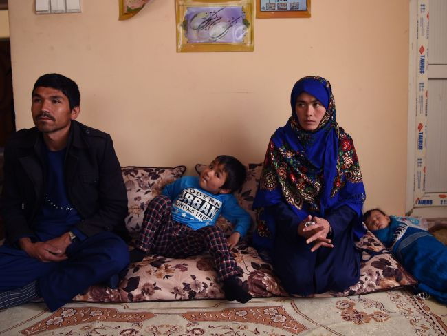 Afghan mother Jahantab Ahmadi with her husband Musa Mohammadi and two of their children. Photo: AFP / Wakil Kohsar