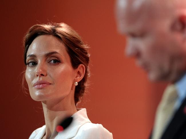 War zone ... Jolie listens as co-host Britain's Foreign Secretary William Hague makes his opening speech at the start of the four-day Global Summit to End Sexual Violence in Conflict. Picture: Getty