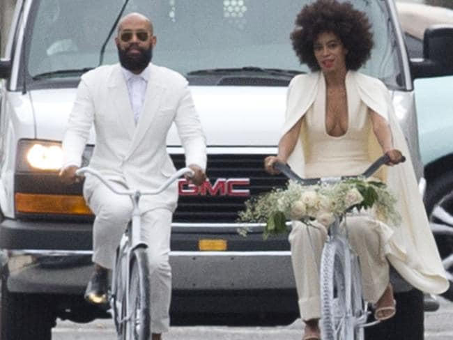 Solange Knowles and Alan Ferguson arrive at their wedding on white bicycles. The couple cycled to their New Orleans wedding in all white. Picture: Splash
