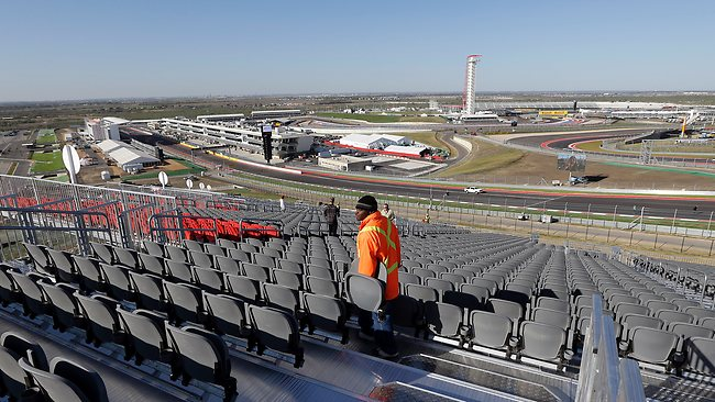 Deshawn Jones looks for a spot to install a chair on the grandstand at turn one of the Circuit of the Americas race track. Picture: AP