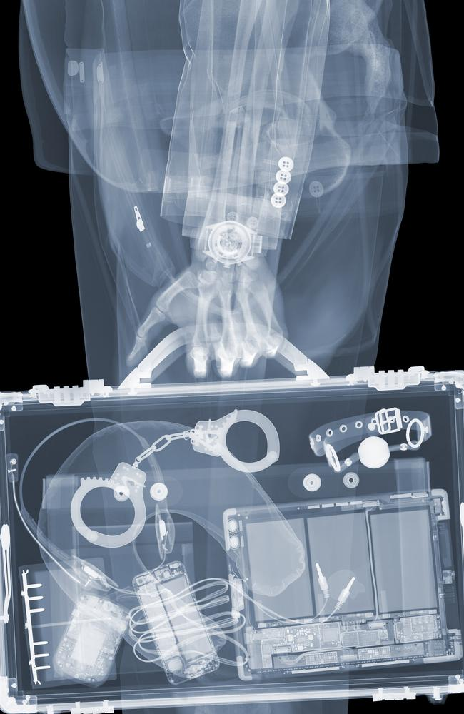 No secrets ... handcuffs and phones can be seen when this briefcase is put through an X-ray. Picture: Splash