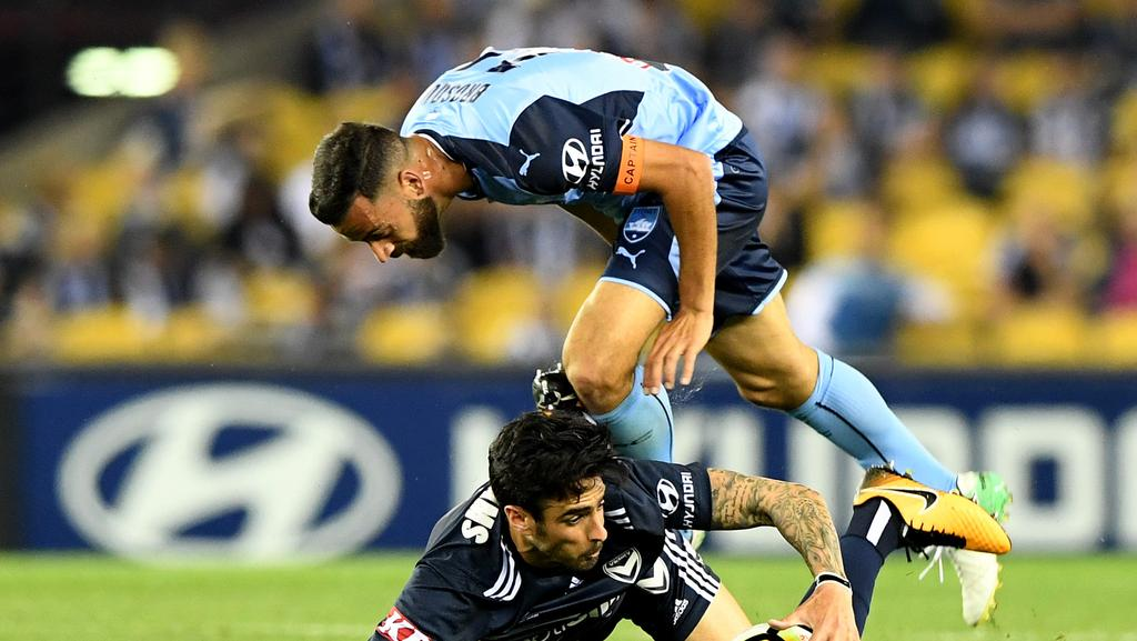 Rhys Williams is tackled by Alex Brosque during the round 1 A-League clash. Picture: AAP