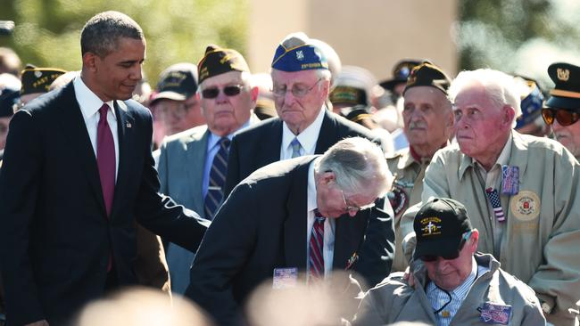 never forgotten ... US President Barack Obama stands with US veterans during a joint French-US D-Day commemoration ceremony at the Normandy American Cemetery and Memorial. Picture: Damian Meyer