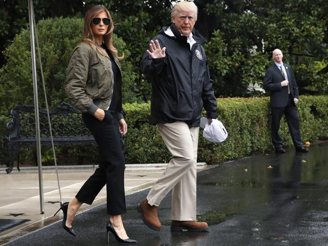 President Donald Trump, accompanied by First Lady Melania Trump, who was called a Barbie for wearing heels. Picture: AP Photo/Jacquelyn Martin