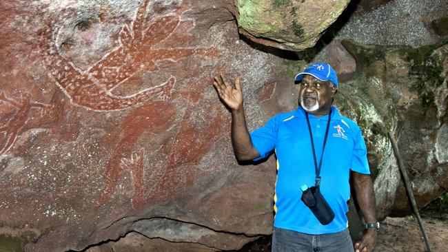 Wilfred (Willie) Gordon and the Wangaar-Wuri cave paintings. Picture: Supplied