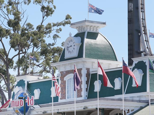 The Australian flag flew at half-mast at Dreamworld on October 25, 2017 — one year on from the tragedy. Picture: Jono Searle/Getty Images)