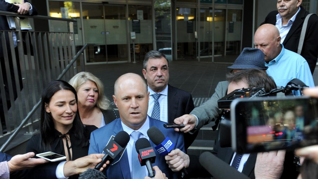 Horse trainers Danny O'Brien and Mark Kavanagh (right) speak to the waiting media outside the VCAT, after their successful appeal against their cobalt disqualifications in Melbourne, Friday, March 17, 2017. A Victorian tribunal has dismissed cobalt charges against Mark Kavanagh and Danny O'Brien. (AAP Image/Joe Castro) NO ARCHIVING