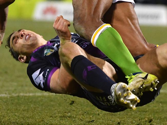 Billy Slater of the Storm is knocked out by Iosia Soliola of the Raiders during the Round 20 NRL match between the Canberra Raiders and the Melbourne Storm at GIO Stadium in Canberra, Saturday, July 22, 2017. (AAP Image/Mick Tsikas) NO ARCHIVING, EDITORIAL USE ONLY