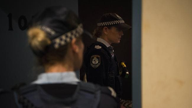Police question an occupant at The Astoria Hotel in Kings Cross. Picture: Chris McKeen