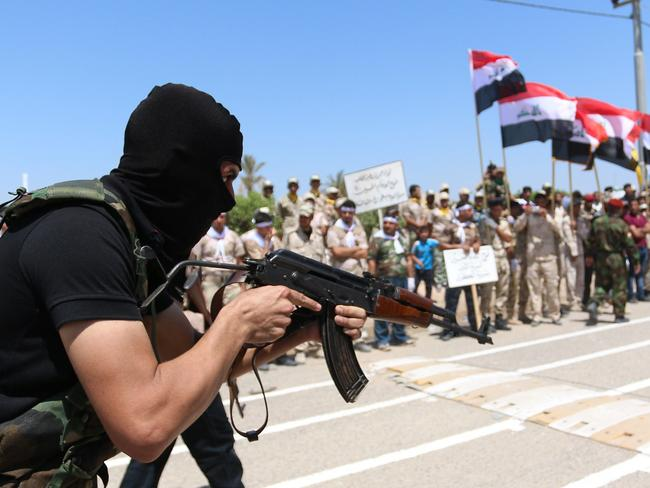 Iraqi Shiite volunteers who have joined government forces to fight Sunni jihadists from the Islamic State (IS) take part in a training session near the southern port city of Basra. Picture: AFP/Haidar Mohammed Ali