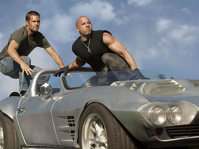 Brian O'Conner (Paul Walker) and Dom Toretto (Vin Diesel) in a scene from film 'Fast & Furious 5'.