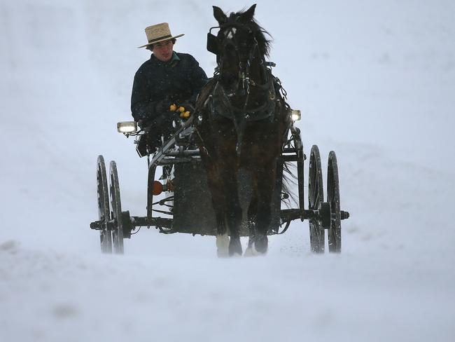 Old school ... an Amish man drives his buggy through heavy snow and wind in Mechanicsville, Maryland. Picture: Mark Wilson/Getty Images/AFP