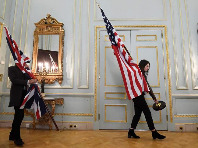 Assistants with a British and American flag. Donald Trump has yet to visit the UK since becoming president. Picture: AFP/Toby Melville