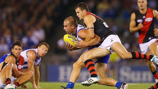 Brent Stanton puts the clamps on Ben Cunnington. Photo by Michael Dodge