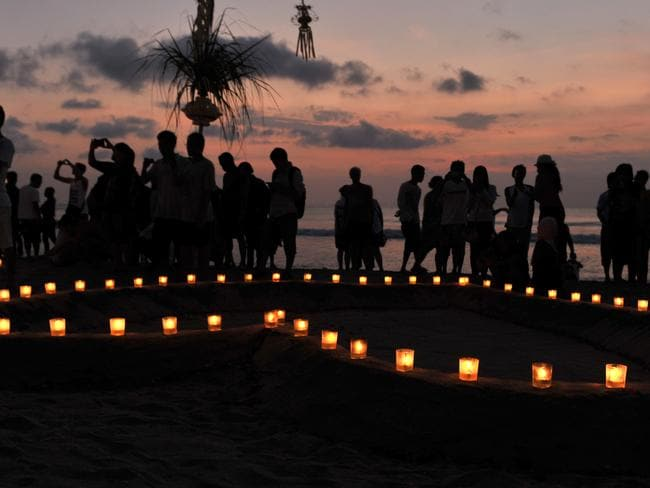"""Hundreds of Balinese and Australians turned up for the """"Paddle for Peace"""" ceremony at Kuta Beach to mark the 10th anniversary of the Bali bombings in 2012."""