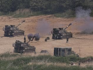 In this Monday, May 22, 2017 photo, South Korean army's K-55 self-propelled howitzers fire during the annual exercise in Paju, near the border with North Korea, South Korea. South Korea's military said Tuesday, May 23, 2017, it fired warning shots at an unidentified object flying south from rival North Korea. (Lim Byung-shick/Yonhap via AP)
