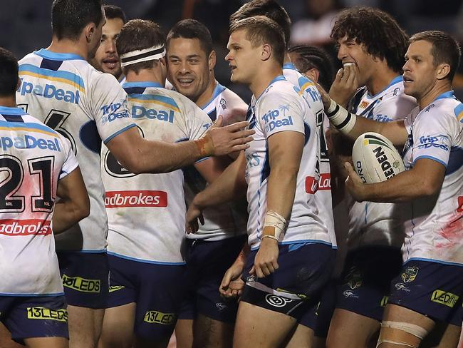 Jarryd Hayne of the Titans celebrates with his team mates after scoring a try.
