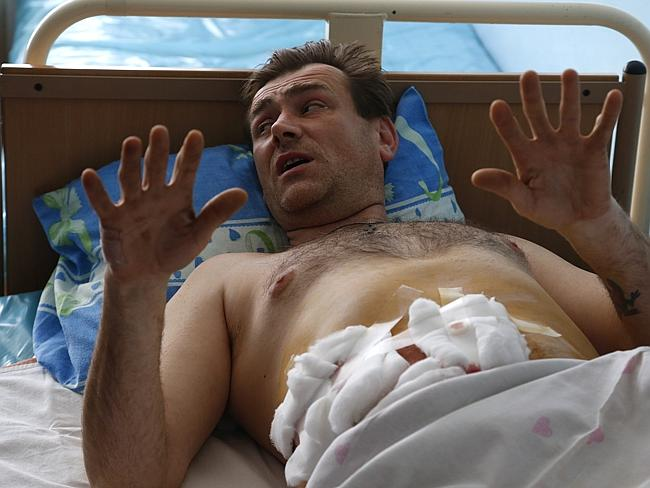 Three killed...Sergei Shevchenko, a pro-Russian protester wounded in the storming a Ukrai