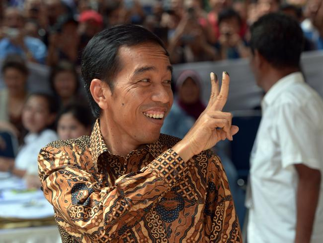 Confident of success ... presidential candidate Joko Widodo gestures after voting in Jakarta. Picture: Adek Berry