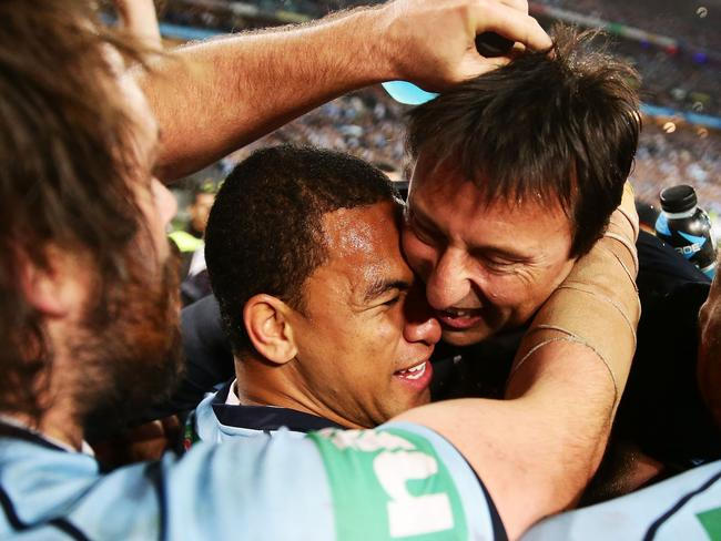NSW Blues coach Laurie Daley celebrates with Will Hopoate after his side sealed the State of Origin series.