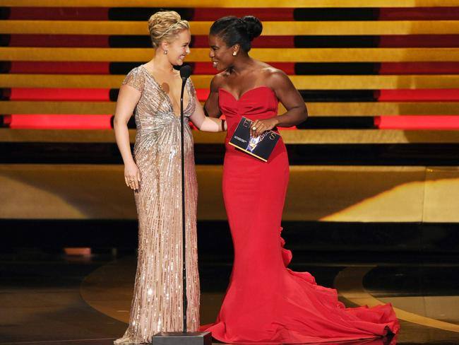 Hayden Panettiere and Uzo Aduba present the award for outstanding directing for a comedy series on stage at the 66th Annual Primetime Emmy Awards.