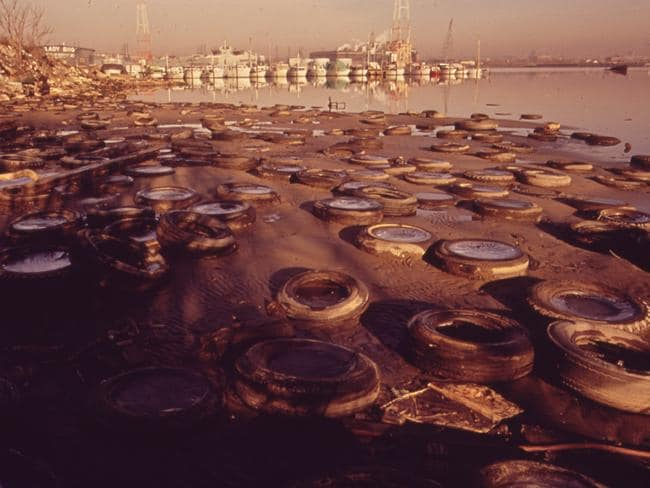 Trash and old tires litter the shore at the middle branch of Baltimore harbour. 1973. Picture: Jim Pickerell/Documerica/US National Archives