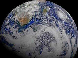 FILE - This file image provided by NASA consists of data from six orbits by the Suomi-NPP spacecraft on April 9, 2015, that has been assembled into this perspective composite of southern Africa and the surrounding oceans. The image was created by the Ocean Biology Processing Group at NASA's Goddard Space Flight Center in Greenbelt, Maryland. The space agency posted to its website on Sept. 20, 2017, to debunk numerous false reports that the world would end on Sept. 23. (NASA via AP, File)