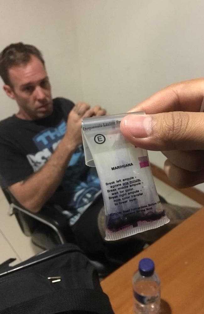 Australian man Joshua James Baker has been detained in Bali for alleged drug possession. Mr Baker can be seen in custody alongside the drugs that were found.