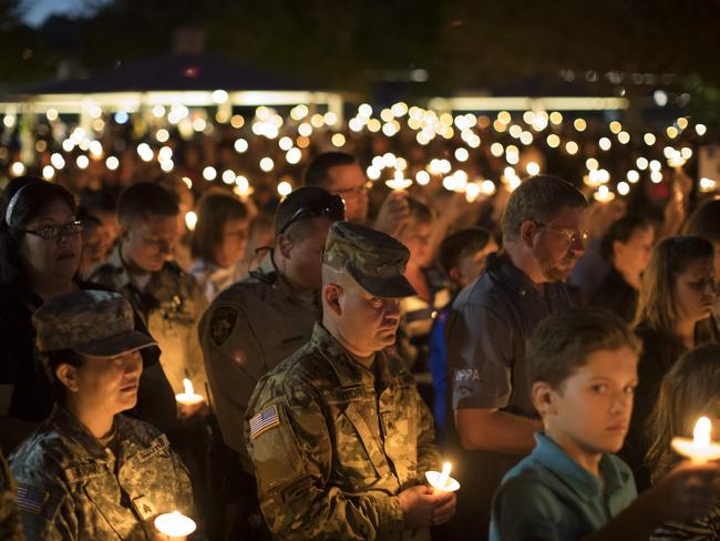 Community members hold candles as they attend a vigil for fallen Las Vegas Metropolitan Police Department Officer Charleston Hartfield at Police Memorial Park in Las Vegas, Nevada. Picture: AFP