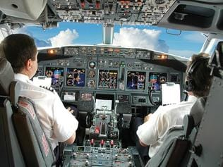 Pilots in the cockpit during a commercial flight