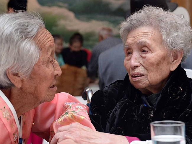 South Korean Lee Young-Shil,88, meets with her North Korean sister Lee Jung-Shil during a family reunion after being separated for 60 years. Picture: Getty Images