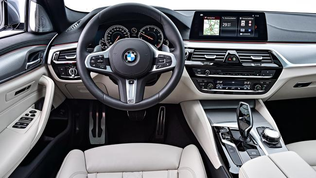 5 Series cabin: Leather trim, seven airbags and BMW's latest infotainment.