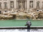 A man looks at the Trevi Fountain during a snowfall, in Rome, Monday, Feb. 26, 2018. Romans have awoken to a rare snowfall, after an Arctic storm passing over much of Europe dumped enough snow to force schools to close and public transport to reduce services. Picture: AP