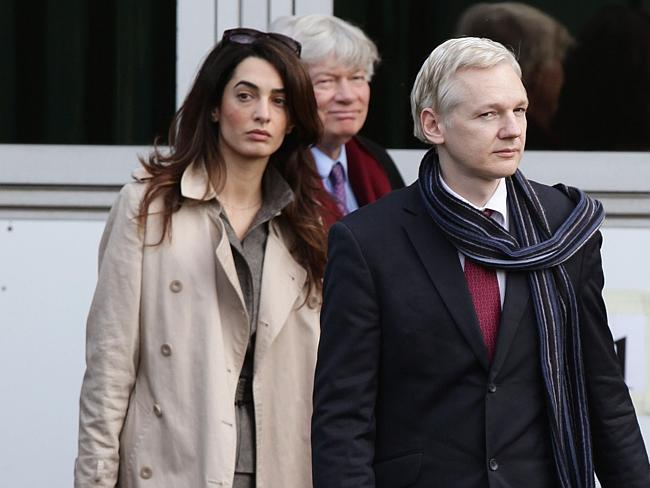 Amal Alamuddin, left, is seen walking alongside WikiLeaks founder Julian Assange as they leave Belmarsh Magistrates Court in south East London after his extradition hearing to Sweden to be prosecuted over claims of sexual assault.