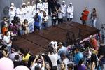<p>Journalists inspect the world's biggest chocolate brick in Yereven on September 11, 2010. Armenian Company broke Guinness World Record for biggest chocolate bar weighing 4410 kilogramms. The bitter chocolate bar measuring 5.6 x 2.75 x 0.25 metres was manufactured in accordance to traditional technology, using Ghana-imported cocoa beans. The previous record was set in Italy in 2007 where a chocolate bar that weighed 3580 kg was made, PanArmenian agency reports. AFP PHOTO</p>