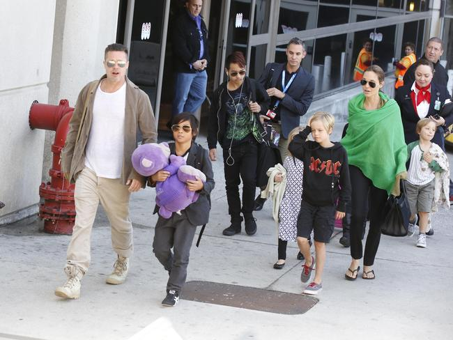 Big family ... Brad Pitt and Angelina Jolie with their brood at Los Angeles Airport. Picture: GVK/Bauer-Griffin/GC Images