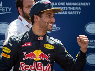 Infiniti Red Bull Racing's Australian driver Daniel Ricciardo celebrates in the parc ferme during the qualifying session at the at the Monaco street circuit, on May 28, 2016 in Monaco, one day ahead of the Monaco Formula 1 Grand Prix. / AFP PHOTO / ANDREJ ISAKOVIC