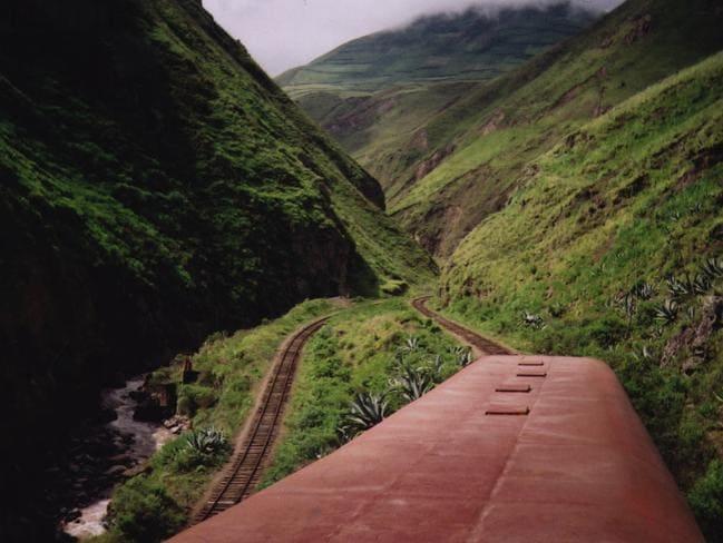 The train passes through lush countryside.