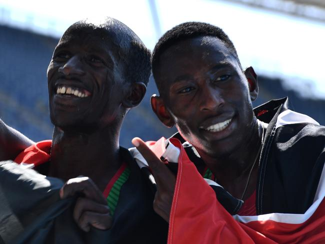 Gold medallist Conseslus Kipruto (right) and bronze medallist Ezekiel Kemboi dominated the men's 3000m steeplechase.