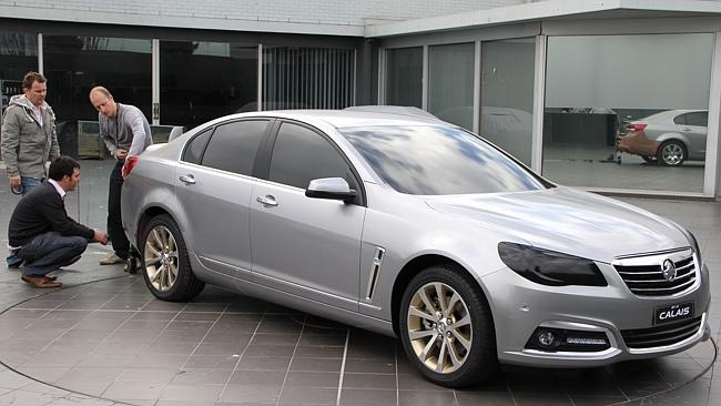 Win for workers ... Holden designers work on a foil-covered clay model of the 2013 Holden VF Calais.