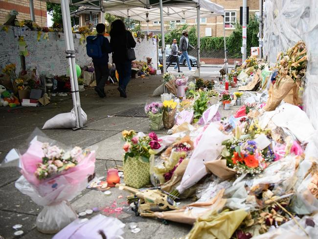Floral tributes are left for those killed in the Grenfell Tower blaze. Residents have vented anger at cost-cutting measures that led to flammable cladding being used on the building. Picture: Leon Neal/Getty Images)