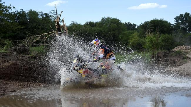 Price tackles a water crossing on the Prologue stage.