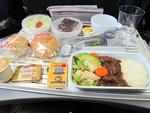 "<p>Scandinavian Airlines served up a treat for one traveller. ""It was a pretty good offering of beef with pretty good vegetables, mashed potatoes, lettuce salad (with tomato), two rolls of bread, butters, sesame crackers with Tillamook cheese, and a chocolate cake with raspberry filling for dessert."" / Flickr user Brianholsclaw</p>"