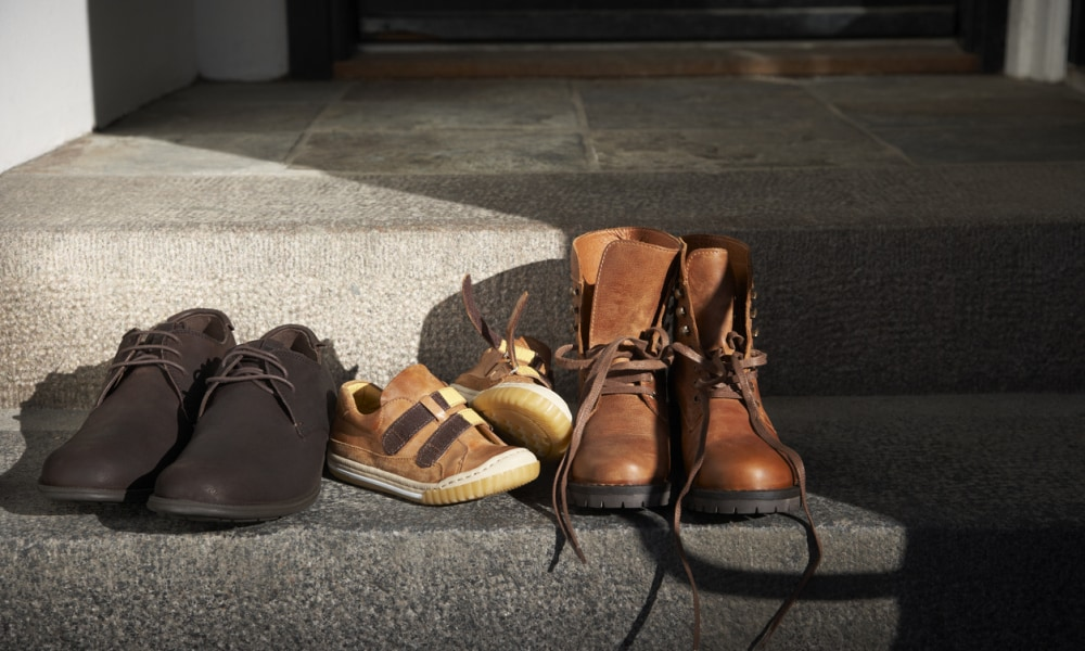 family shoes on doorstep