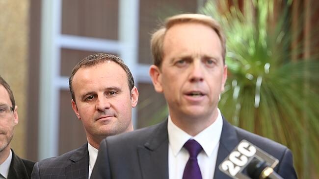 Deputy Chief Minister Andrew Barr, left, listening to ACT Attorney-General Simon Corbel speak to the media after he introduced the Marriage Equality Bill 2013 into the ACT Legislative Assembly in Canberra.